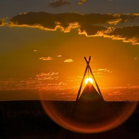 This is where the cowboys sleep during round-up at the 06 Ranch in West Texas.  Waited on my belly for the sun to peak at top of the teepee and b...