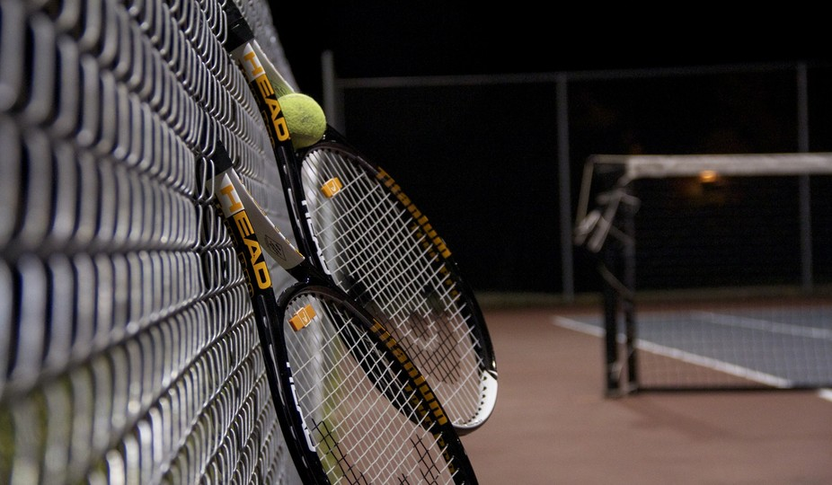 Still Life shot of tennis rackets with a tennis ball. Resembles getting ready for a tennis match.