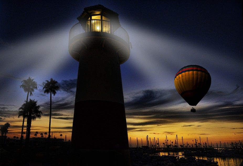 A lighthouse in Oceanside Harbor lights up the skies.