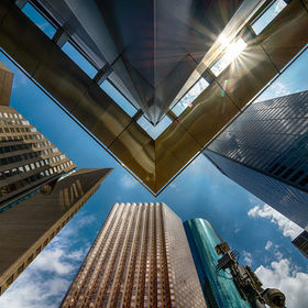 Looking up in the Skyline District in Houston, I captured the corner of the Total Building with its neighbors, the Hyatt Regency, Enterprise Plaz...