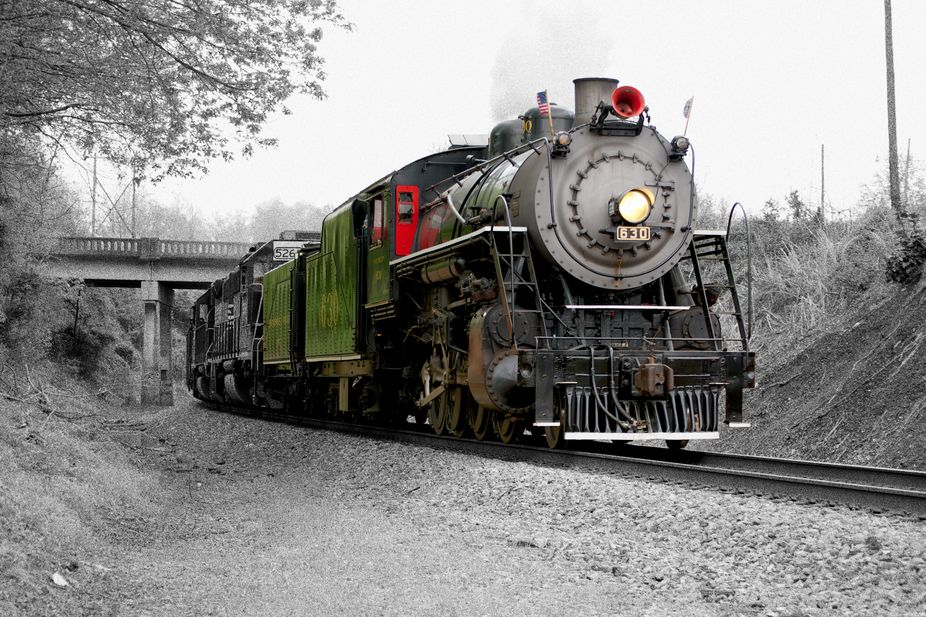 An old Steam Engine moving through the state.