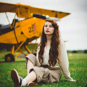 Vintage girl with an airplane