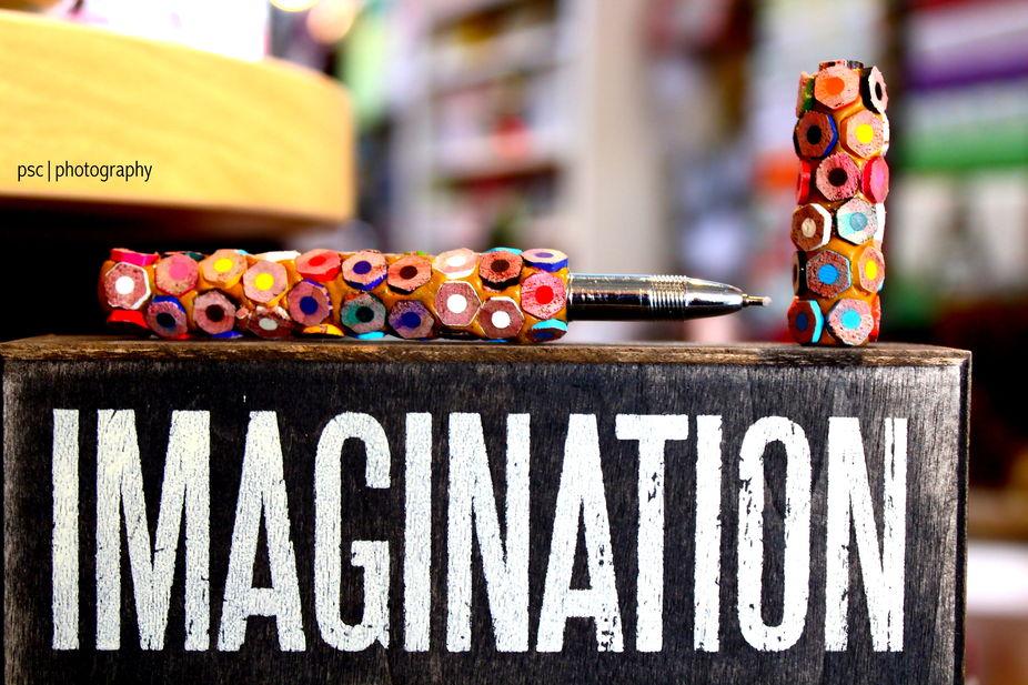Coloured pencils used to make a pen. Imagination.