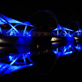 Tempe Pedestrian Bridge lit at night.