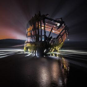 Story behind the photo:  I went to photograph this shipwreck at sunset, and at night with star trails. However, typical Oregon Coast weather show...