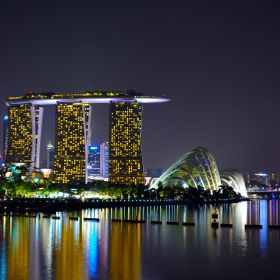 Like a jewel that sparkle in the night, this landscape is the pride of our country. A view from the Marina Barrage looking into the city where Ma...