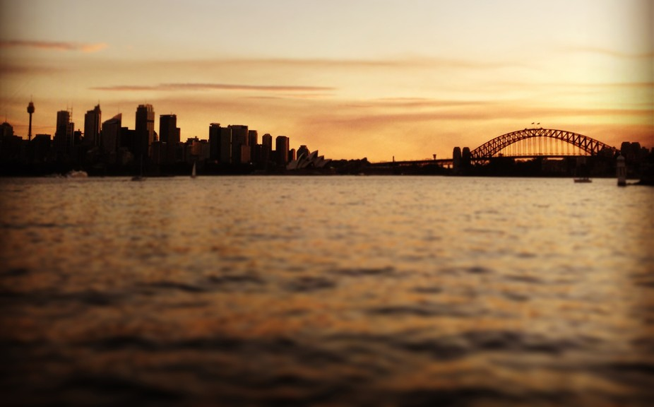 View of Sydney Harbour at dusk from a boat from North Shore. Sydney, Australia.