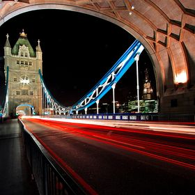 This old romantic Tower bridge in London comes alive at night.