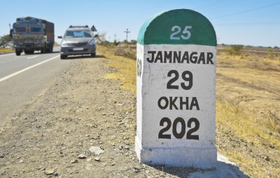Jamnagar direction milestone State Highwway 25