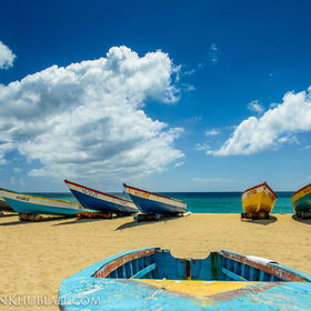 Nevis, West Indes.   The local fishermen use these boats to catch fish every morning... the boats are stored on the beach in the day waiting for ...