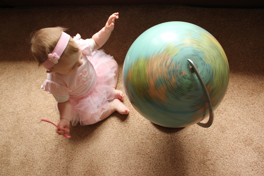 Baby finds a new form of spinning top.
