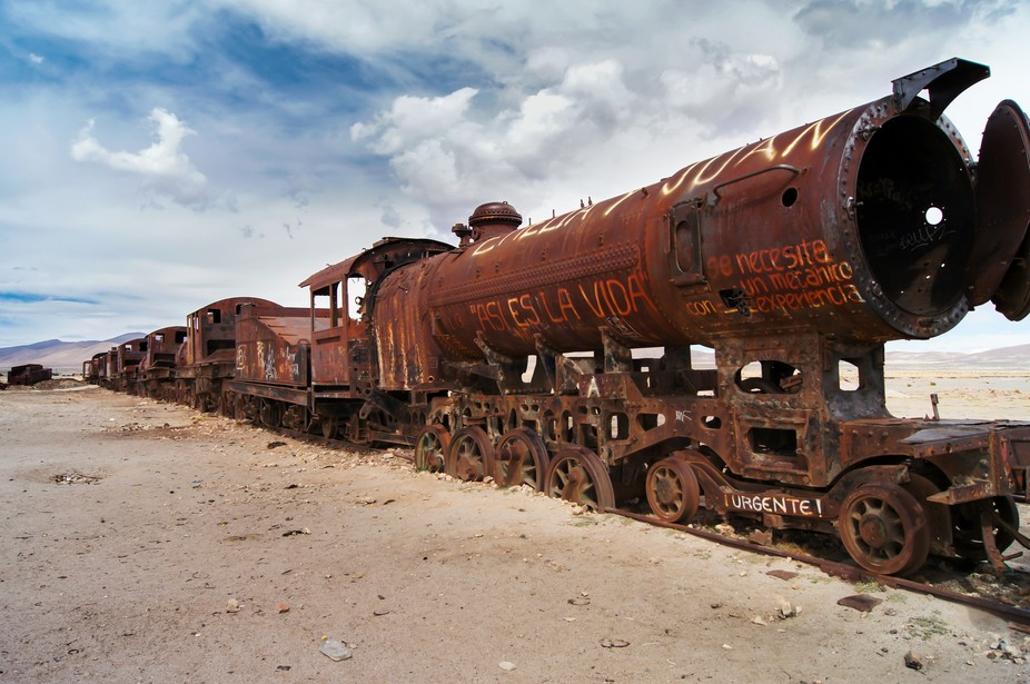 A little outside of Uyuni, Bolivia, locomotives and cars of trains that were retired in the 1960s...