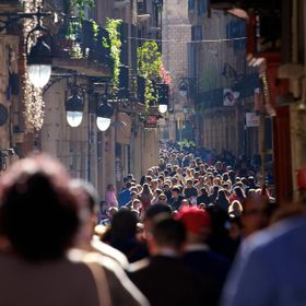 View of the crowds of people in the Old Town area of Barcelona.