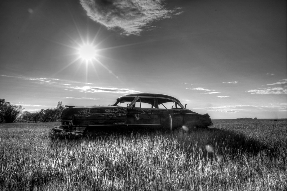 old car in field southern Manitoba.