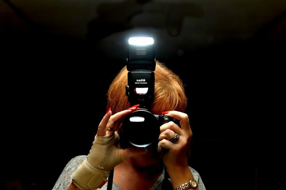 Mirror shot of a photographer