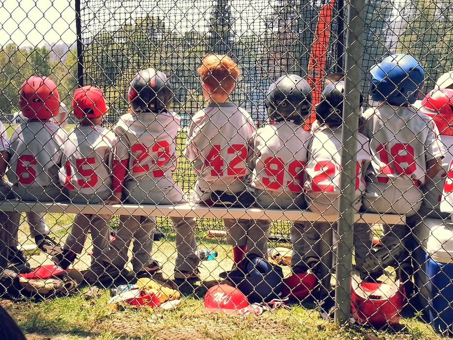 Six-year-old All-Stars, watching anxiously from the bench.