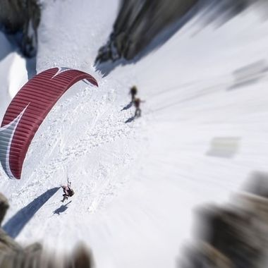 A Paraglider taking off at over 3000  metres above the Argentiere Glacier, in Chamonix.