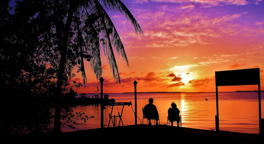 Two photographers are captured photographing this breathtaking sunset in Key Largo, Florida.