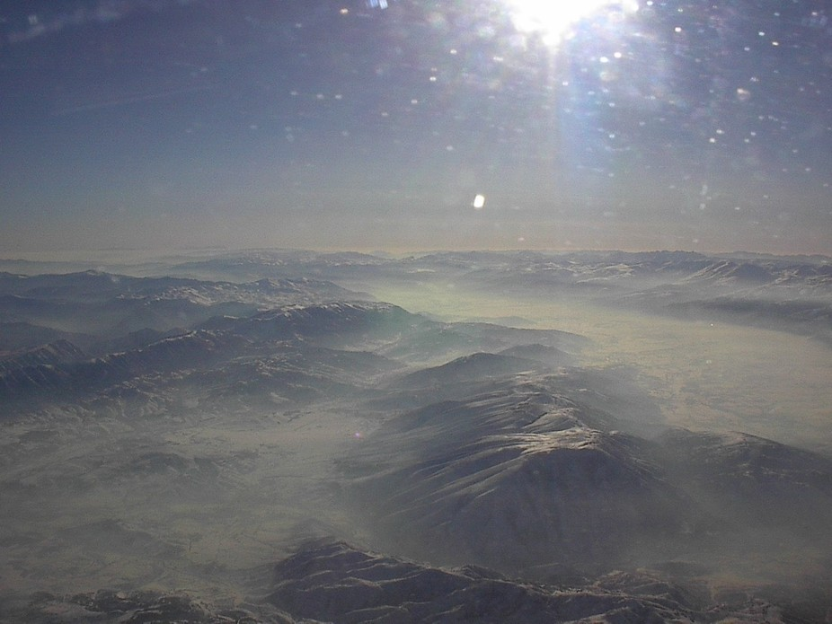 Photo was taken in a plane while in route to Kosovo.  This is a picture of the Balkan mountain.