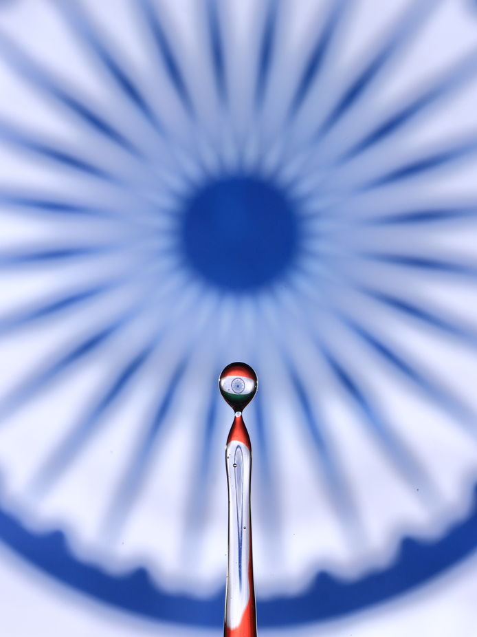 Seen here,  Indian National Flag through a water droplet splashed back in the air.