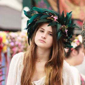 This young lady was selling flower headpieces  I had taken this at the New York Renaissance Fair.