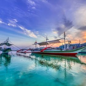 These banka (boats) are mainly use for tourists on island hopping and also by divers. Taken at sunrise in El Nido, Palawan