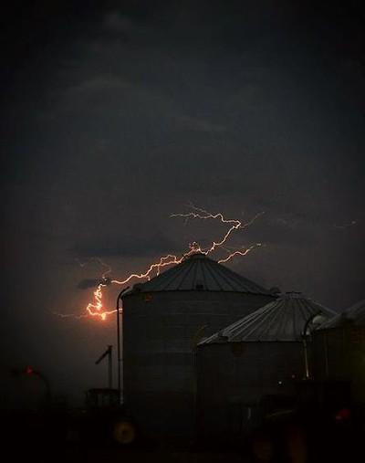 Lightning behind a grain bin