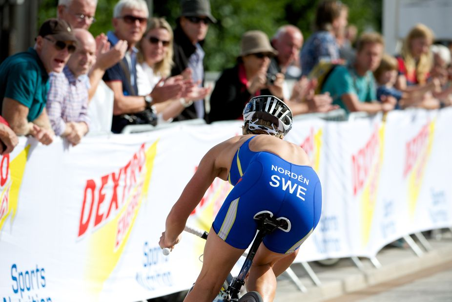 Swedens Lisa Nordén passing on the bike in ITU games in stockholm 2013. Did not so great here ...