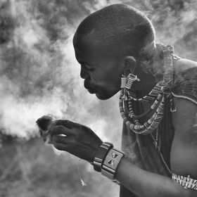 massai warrior making fire