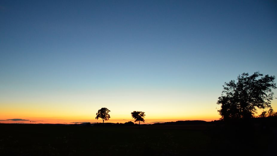 Sunset over the Ore Mountains (German: Erzgebirge, Czech: Krušné hory) in Saxony, Germany. The ...