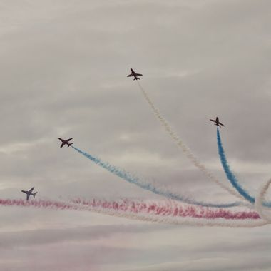 Flying display by the Red Arrows team of the Royal Airforce.