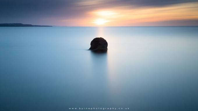 Lone Black Rock by byrnephotography - Composing with Negative Space Photo Contest
