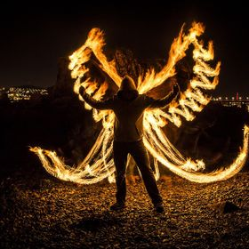 Night photography with fire on the banks of the River Tay, Dundee, Scotland. Getting creative after a spot of Fire breathing!