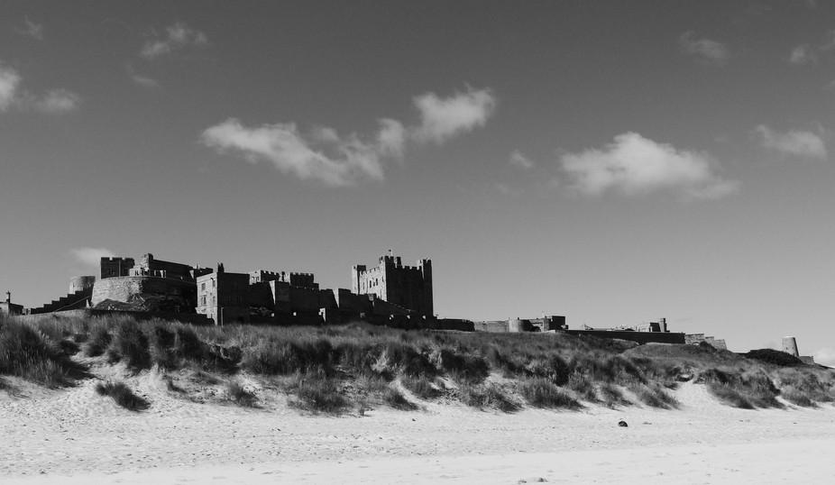 Spanning nine acres of land on its rocky plateau high above the Northumberland coastline Bamburgh...
