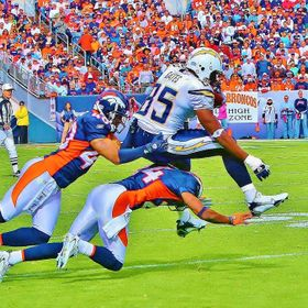 2 professional Denver Bronco's Defense players grab to take down a San Diego receiver defying gravity to grab more yards.