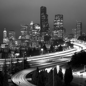 The downtown skyline of Seattle, WA, at night, with the Interstate 5 in the foreground. kjmphotographic.com