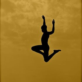 Silhouette of boy jumping.