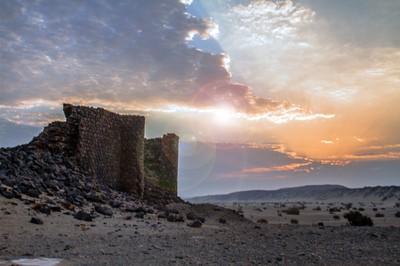 sunrise in desert ruin city