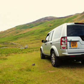 A Land Rover Discovery 4 on the Honister Pass in the Lake District of England.