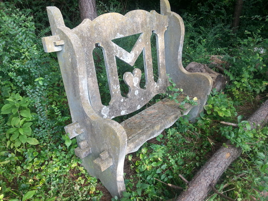 Concrete bench with M in the back, and a heart in the middle