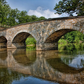 Beautiful summer day at the Burnside Bridge-Antietam National Battlefield-Sharpsburg,Maryland.  I love the reflection of those arches.