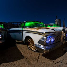 Three Edsels in a junkyard, long exposure in moonlight and light painted in camera using green gelled off-camera flashes for the interiors and ha...