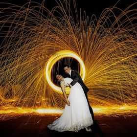 Bride and Groom dip in front of a ring of fire