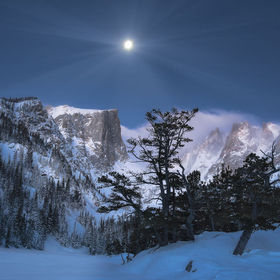 A full moon over Dream Lake with just a touch of early morning light. Taken in Colorado's Rocky Mountain National Park.