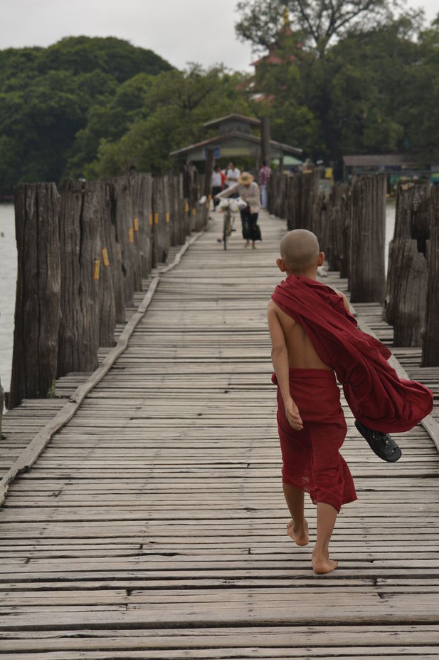 This little Monk was walking past me in Myanmar, on one of the longest wooden jettys in the world.