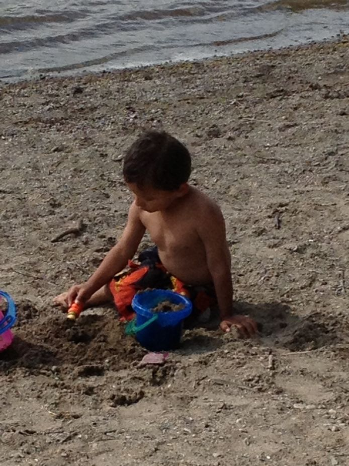 My Grandson building his first ever Sand Castle
