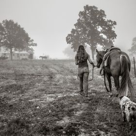 Early, early in the morning just as the fog was lifting, the woman walked her mount for the day. Her trusty Australian Shepherd was along to assu...