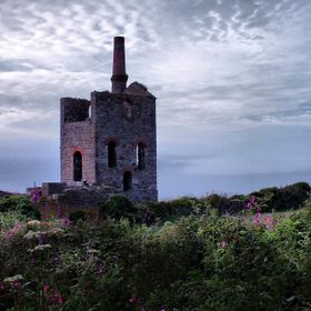 Sunset at the derelict engine house of the Levant Mine in Cornwall. No longer working as part of the tin mine the chimney still stands proud agai...