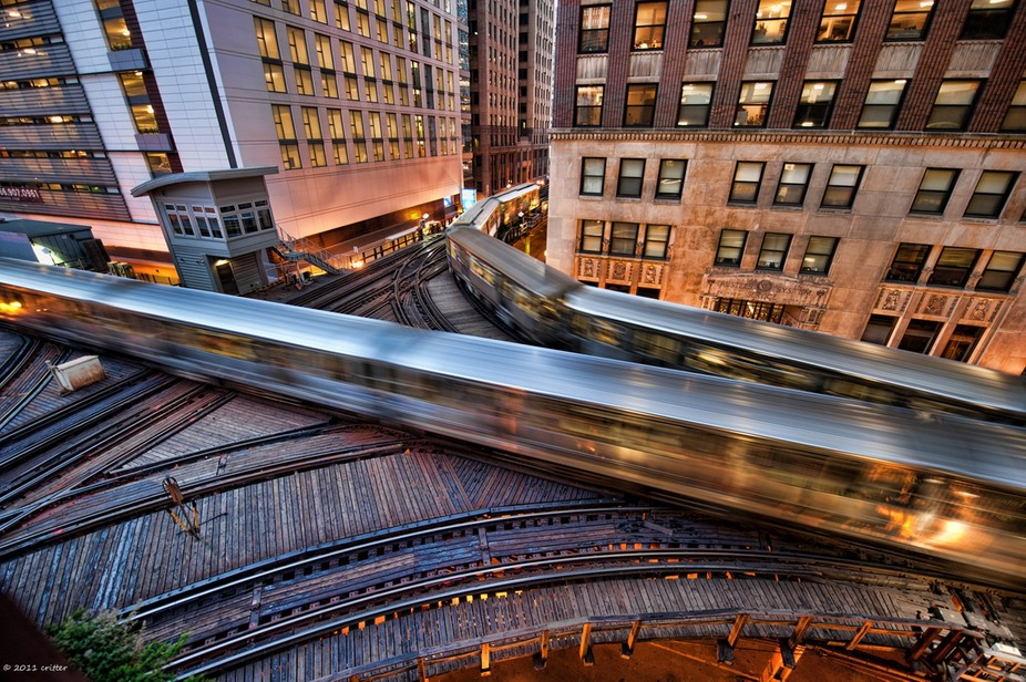 """CTA """"L"""" trains caught during the """"Blue Hour""""."""