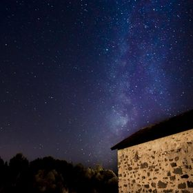 The milky rises over an old stone bunker at Fort Missoula in Missoula, Montana.